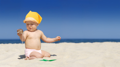 Beautiful baby girl on the beach. The picture was made from three big photos and downsized for better quality.